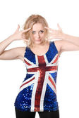 Blonde in union-flag shirt showing gestures — Stock Photo