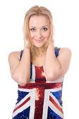 Cheerful blonde wearing union-flag shirt — Stock Photo
