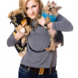 Smiling blonde posing with two dogs — Stock Photo