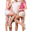 Young man and two playful girls — Stock Photo