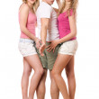 Handsome young man and two beautiful girls — Stock Photo
