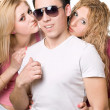Portrait of a two attractive blonde women with young man — Stock Photo