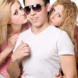 Stock Photo: Portrait of a two attractive blonde women with young man