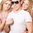Portrait of a two smiling blonde women with young man — Stock Photo