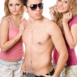 Two smiling beautiful blond women with young man — Stock Photo #6916363