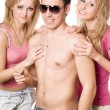 Two happy blonde women with young man — Stock Photo