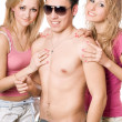 Two happy blonde women with young man — Stock Photo #6916390