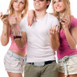 Two smiling blonde woman and young man — Stock Photo