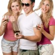 Two playful blonde woman and young man — Stock Photo
