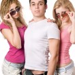 Two beautiful blonde women with handsome young man — Stock Photo