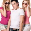 Two pretty blonde women with handsome young man — Stock Photo