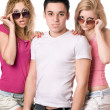 Two sensual blonde women with handsome young man — Stock Photo