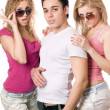 Two passionate blonde women with handsome young man — Stock Photo