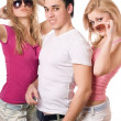 Two playful blonde women with handsome young man — Stock Photo