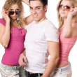 Two blonde women with handsome young man — Stock Photo