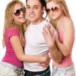 Two joyful women and handsome young man — Stock Photo