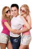 Two cheerful women and handsome young man — Stock Photo