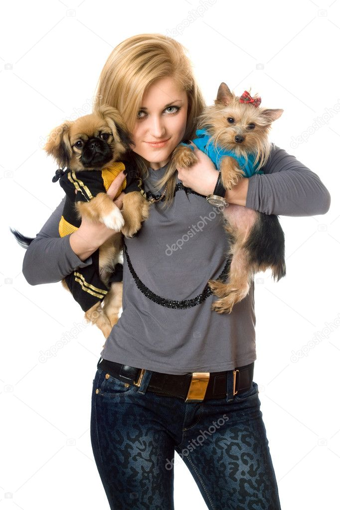 Smiling young blonde posing with two dogs. Isolated — Stock Photo #6915980