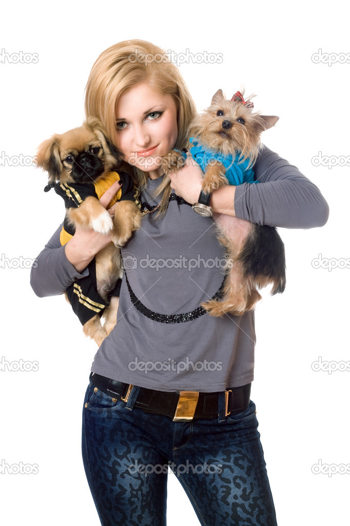 Smiling blonde posing with two dogs. Isolated  Stock Photo #6915981