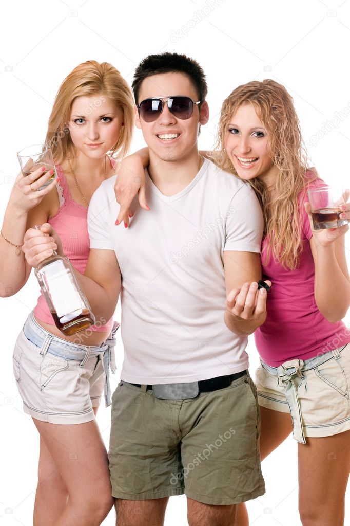 Two beautiful blonde women and young man with a bottle  Stock Photo #6916401
