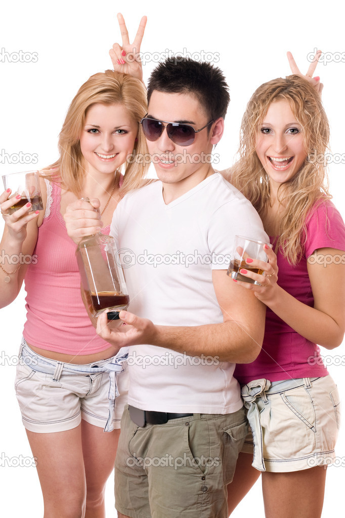 Two joyful blonde woman and young man with a bottle  Stock Photo #6916421