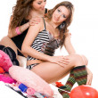 Two playful young girlfriends. Isolated — Stockfoto