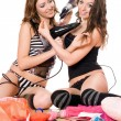 Two smiling young girlfriends with hair dryers — Stock Photo #6979140