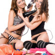 Stock Photo: Two smiling young girlfriends with hair dryers