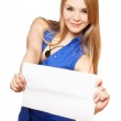 Attractive young woman holding empty white board — Stock Photo #6979164
