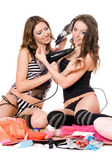 Two smiling young girlfriends with hair dryers — Stock Photo