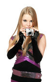 Young beautiful blonde holding a photo camera. Isolated — Foto de Stock