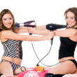 Two playful girlfriends with hair dryers. Isolated — Stock Photo #6993011