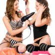 Two cheerful young girlfriends with hair dryers — Stock Photo