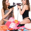 Stock Photo: Two young girlfriends with hair dryers