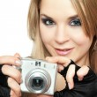 Smiling beautiful woman holding a photo camera — Stock Photo