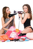Two young girlfriends with hair dryers — Stock Photo