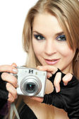 Smiling beautiful woman holding a photo camera — Stock Photo