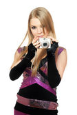 Young pretty blonde holding a photo camera. Isolated — Stock Photo