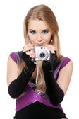Young attractive blonde holding a photo camera. Isolated — Foto de Stock