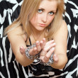 Pretty woman stretches out her hands in chains — Stock Photo