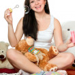 Stock Photo: Cheerful girl blow bubbles. Isolated