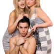 Stock Photo: Two blonde and guy in chains