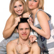 Royalty-Free Stock Photo: Two playful blonde and a guy in chains
