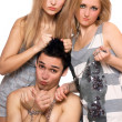 Two playful girls and a guy in chains — Stock Photo