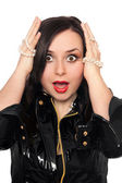 Shocked young woman in black jacket — Stock Photo