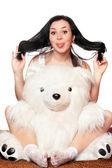 Cheerful girl with a teddy bear — Stock Photo