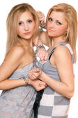 Two beautiful young women bound a chain — Stockfoto