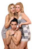 Two blonde and a guy in chains — Stockfoto