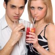 Attractive young couple with cocktails. Isolated — Stock Photo