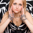 Blonde stretches out her hands in chains — Stock Photo
